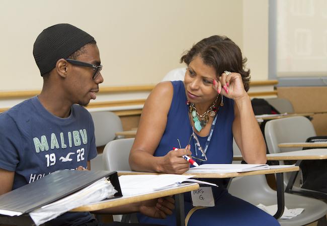 A teacher tutors a student.