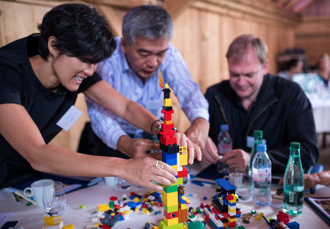 Three participants take part in an ERFIP workshop.