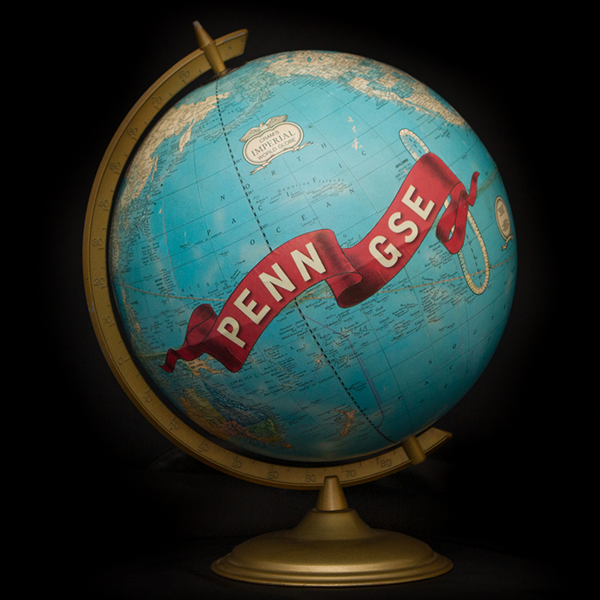 A globe with a Penn GSE ribbon painted on it.