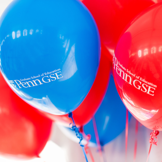 Red and blue balloons sporting the Penn GSE logo
