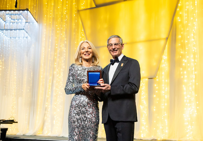 Penn President Amy Gutmann accepts the Pennsylvania Society Gold Medal for Distinguished Achievement.