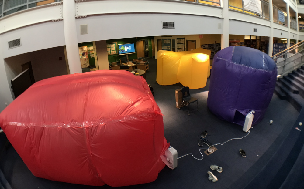 Large inflated colorful structures in an elementary school auditorium
