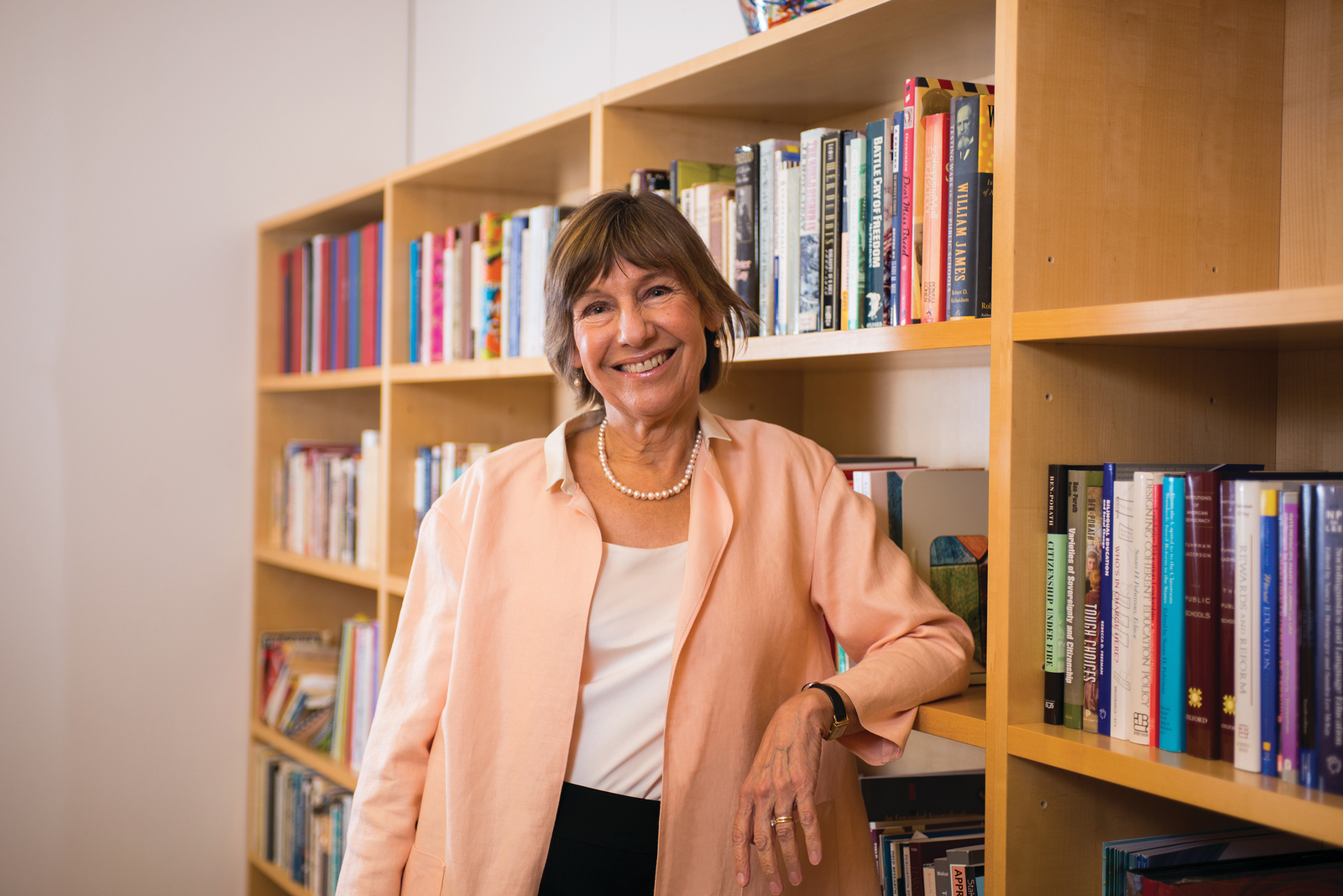 Pam Grossman standing in front of a bookshelf