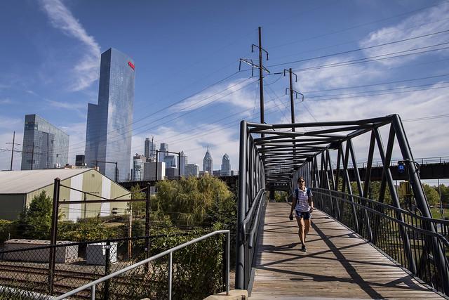 Student crosses bridge at Penn.