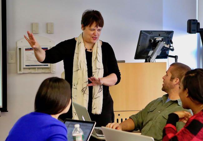 Yasmin Kafai presenting at the front of a classroom