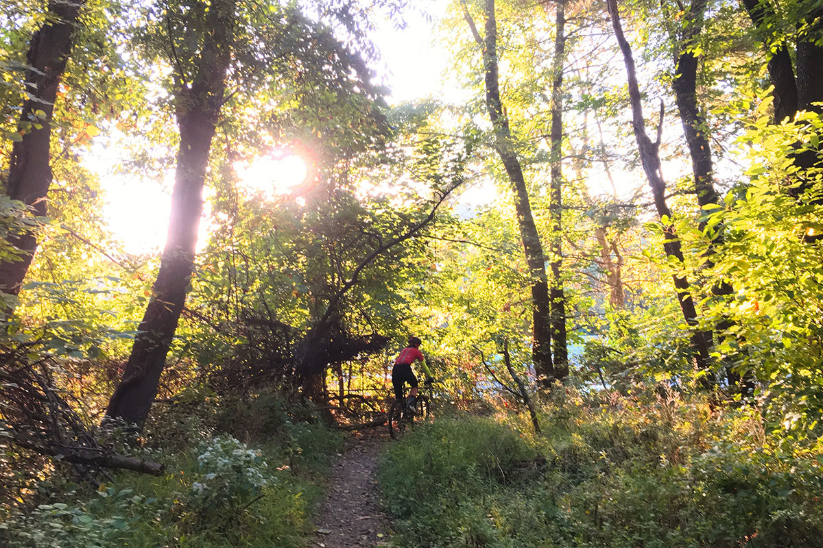 biker crushing a trail as the sun goes down in beautiful fairmount park