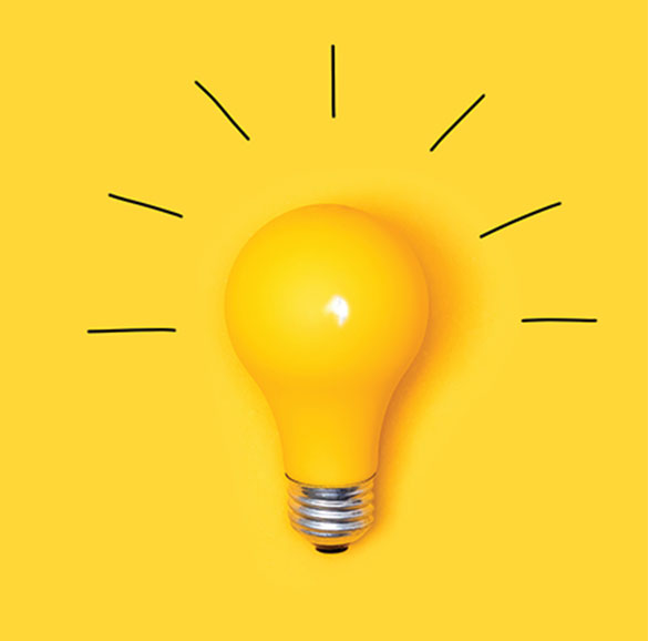 A yellow light bulb appears against a yellow background. Black lines spark outward from the bulb.