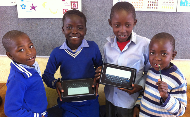 Young people showing their electronic devices.
