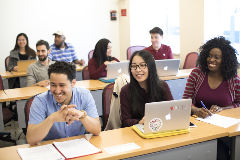 Penn GSE students smile during a class.
