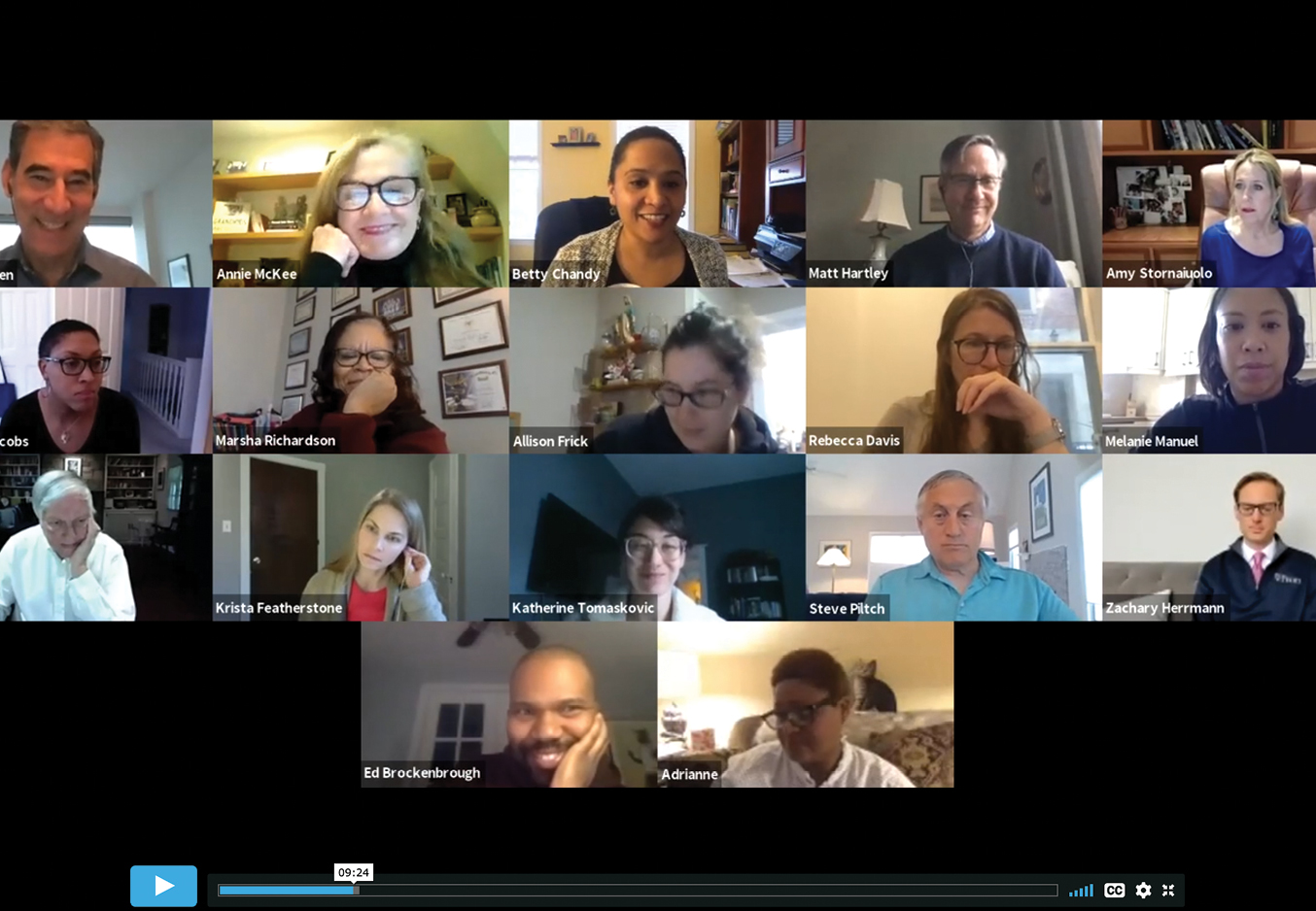 A video call with 17 Penn GSE faculty is screenshotted. Each person's video screen appears in a small box, with many faces smiling or in mid-conversation, and home offices or living rooms are in each of the 17 backgrounds.