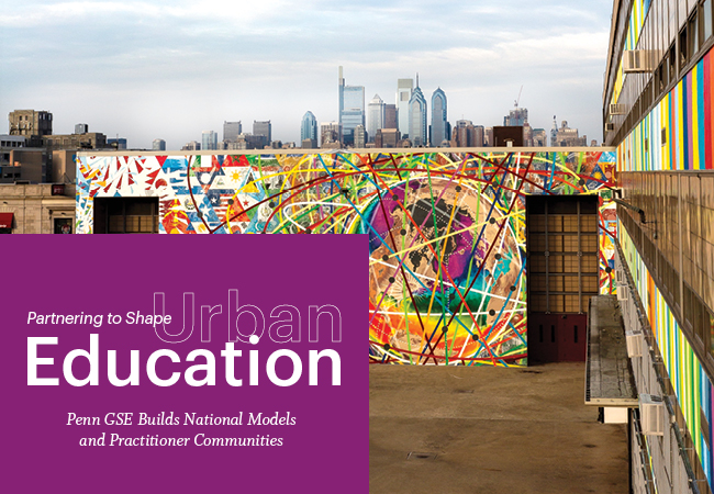 "A colorful mural is painted on a South Philadelphia high school. The Philadelphia skyline is visible behind the school. A purple block in the lower left reads, ""Spring 2020, Partnering to Shape Urban Education"