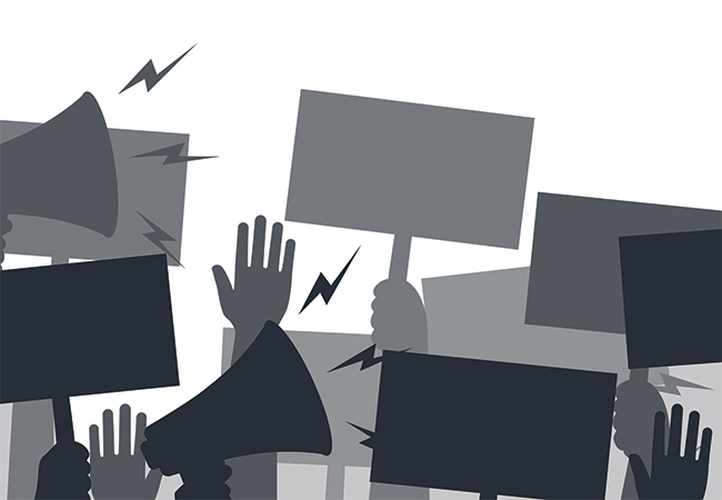 A black-and-white illustration of a protest shows silhouettes of hands raised in the air, signs being held, and noise coming out of megaphones.