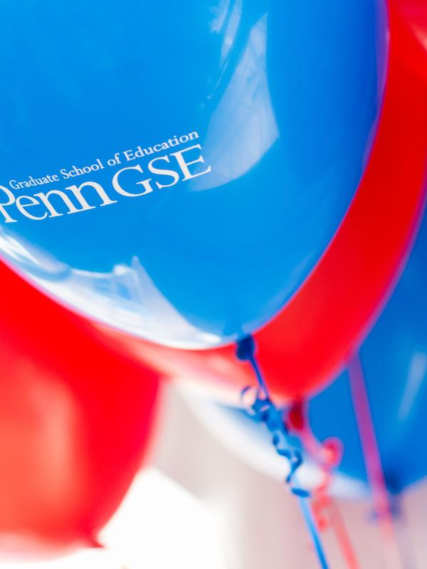 Red and blue balloons sporting the Penn GSE logo.