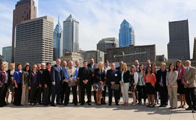 Group shot in front of the Philadelphia skyline