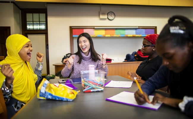 Shiyu Sun (center) is one of the 32 mentors in the Graduate School of Education's Possibility Mentoring Program. Sun is now in her fourth semester working with groups of middle schoolers, like Ciani Patton-Collins (left), at the General George G. Meade School in Philadelphia. (Eric Sucar, Penn Communications)