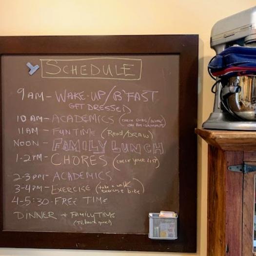 A family schedule written on a chalkboard.