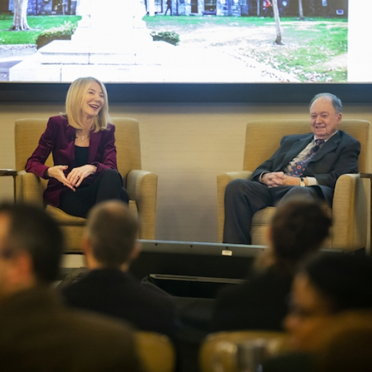 Penn President Amy Gutmann and professor Robert Zemsky talk on a stage.