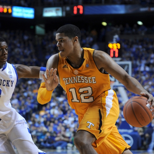 Tobias Harris, left, dribbles a basketball in a 2011 game against the University of Kentucky.