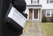 A U.S. Census worker approaches a house.
