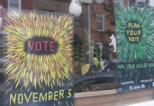 Signs encouraging people to vote.