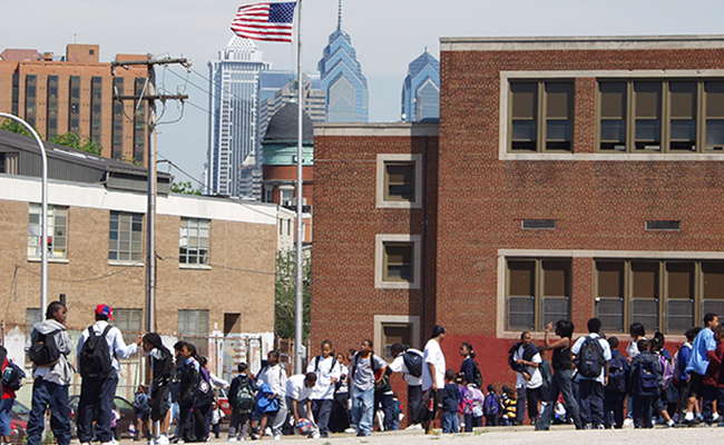 Students wait outside of their school.