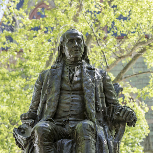 Statue of Ben Franklin outside College Hall.