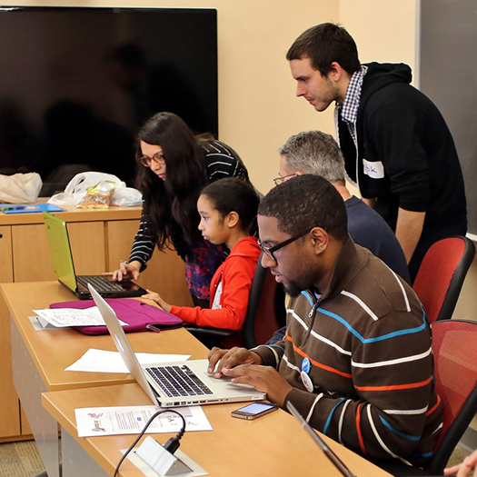 Students learning coding on laptops
