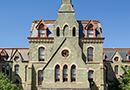 Penn's College Hall against a blue sky