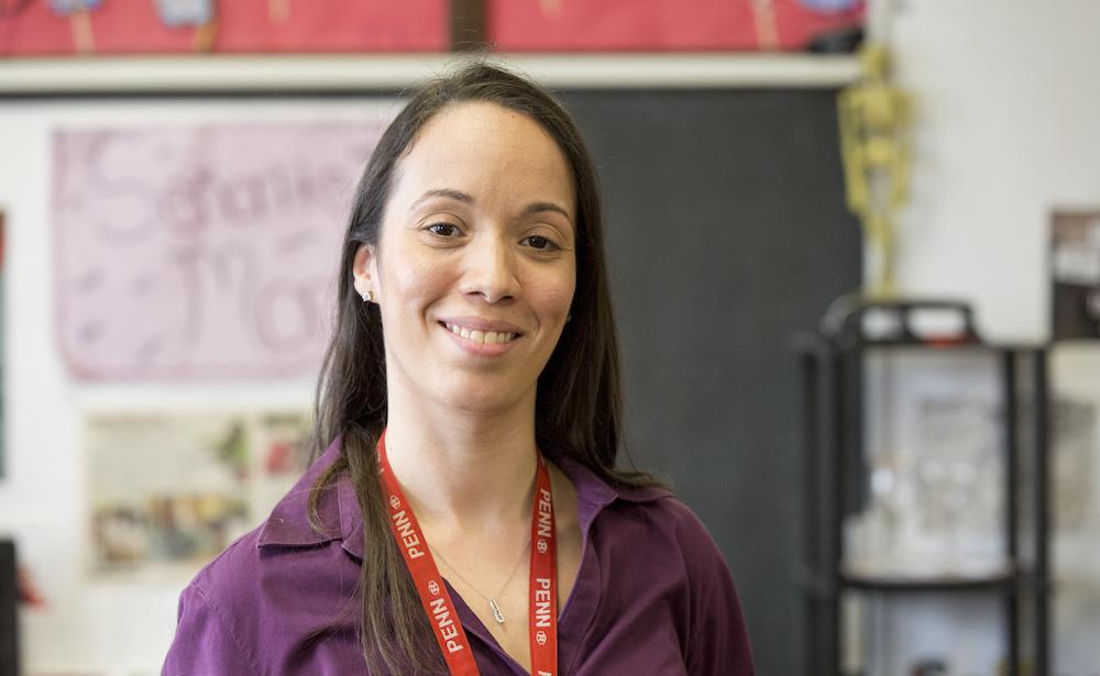 Penn GSE alumna teacher in Philadelphia classroom wearing Penn lanyard