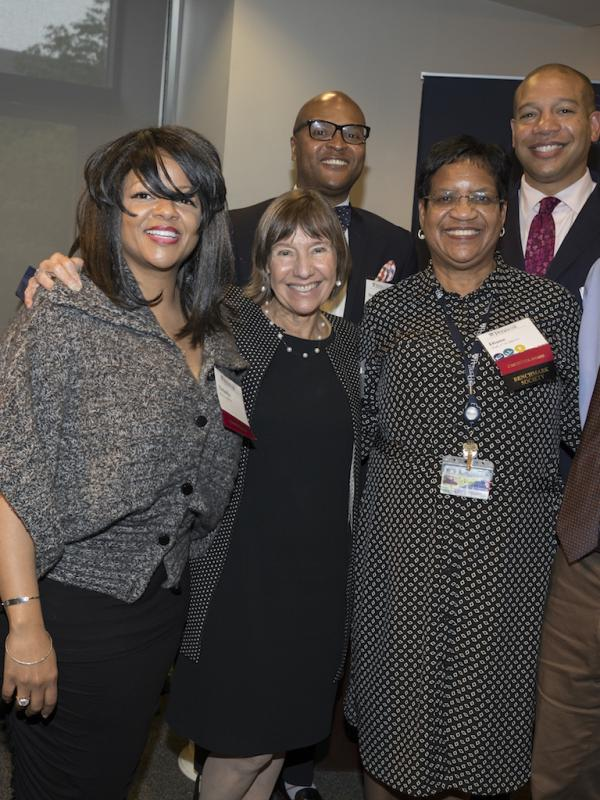 Dean Grossman standing and smiling with award nominees.