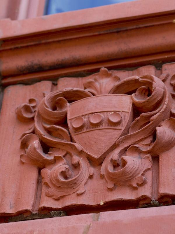 Mold of the Penn Crest on the side of a building