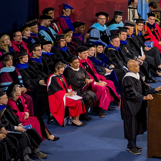Penn GSE faculty seated onstage at Commencement