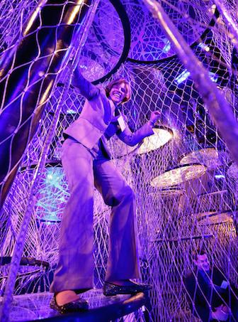 Female superintendent climbing rope exhibit